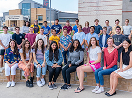 30 high school national merit scholars seated